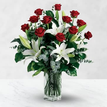 Glass Vase with 12 Red Rose and 5 White Lilies nicely decorated with fillers and greens