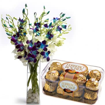 Glass vase with 10 Blue and white Orchids nicely decorated with 16pc Ferroro Rocher Chocolate. Please note: we may substitute flowers or color of flowers incase of unavailibiliy