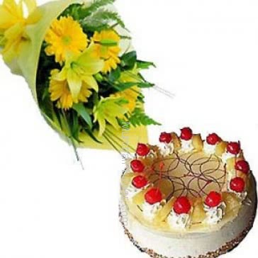 Bunch of 10 Yellow Gerberas nicely decorated with half kg. pineapple cake