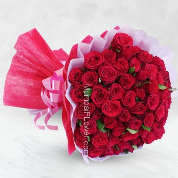 Hand bouquet of 70 Red Roses nicely decorated with paper packing and ribbons, let it speak love aloud
