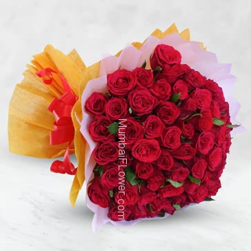 Bunch of 60 Red Roses nicely decorated with fillers ribbons and colored Paper packing, exotic and madly in romance.