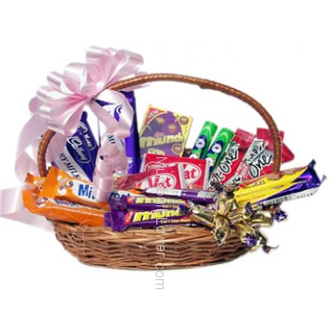 Beautiful Bamboo Basket ofmixed chocolates with a ribbon bow , contains mixed chocolates of Mrp.700