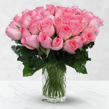 A rare and beautiful rose for someone special. 80 Pink Roses in a Vase nicely created with fillers .