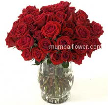 Wishes for a sweet and love filled Valentines Day! Glass Vase with 40 Valentine Red Roses.