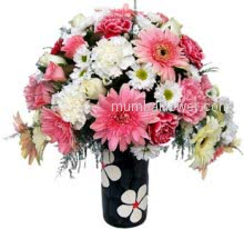 White flower is a symbol of happy love and the combination of White and Pink Mixed Flowers in a Glass Vase for your happy loving love.