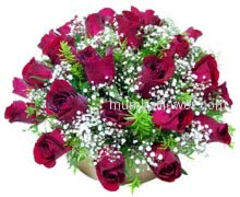Beautifully Round Arrangement 30 stems of Red Roses nicely decorated with Greens.