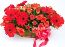 Red and Gerbera bunch of Fresh and Rich Flowers to be ordered online as gift or on special occasion to be with Basket of 10 Orange or Red Gerberas and 24 Roses.