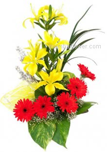 Combination of 4 Yellow Lilies and 5 Orange Gerberas with nicely arranged for your special occasion.