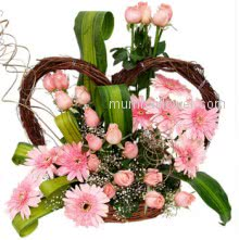 To impress your be loved send them nicely arrangement of 15 Pink Gerberas and 40 Pink Roses nicely decorated with Greens.