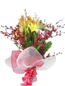 Bunch of Mixed Exotic Flowers wrapped wih net and a Ribbon bow is so romantic energetic.
