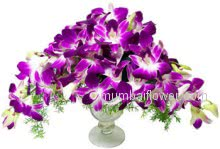 Purple orchids are beautiful in arrangements. Whether a deep purple or lavender shades, purple orchid arrangements are sure noticeable. Glass Vase With 15 Purple Orchids