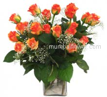 An eye-catching orange roses to send your warmest wishes to friends, family and loved ones Vase with 20 Stems of Orange Roses