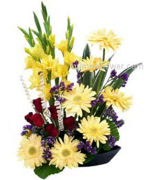 A Beautiful Arrangement of 6 Gladioli, 6 Yellow Gerberas and 10 Red Roses.to express the happiness and energy for any occasion to your dear ones or friends or coligues