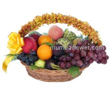 An arrangement of mixed fruits and flowers with a ribbon bow, A wonderful gift.