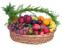A basket of mixed fruits with foliage beautifully decorated a devine gift.