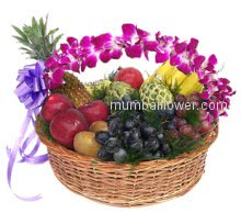 Basket of mixed fruits and purple orchids with a ribbon bow. Gift to your grand parents.