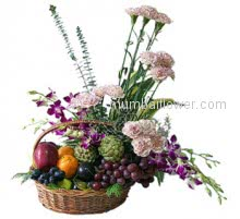 A wonderful arrangement with purple orchids and carnations with mixed fruits in a beautiful basket.