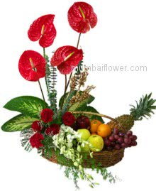 Tray with red anthuriums,carnations,white orchids and fruits a beautiful decoration.