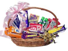 The bank of friendship cannot exist for long without deposits of chocolate. so give this Basket of mixed chocolates with a ribbon bow to your friends, family and your love.