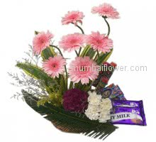 Give this beautiful combination of flowers and chocolates with Basket of Mixed Flowers with Mixed Dairy Milk and Gems Chocolates.