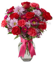 Lovely Mixed Flowers in a Vase Beautifully decorated with a ribbon, a fantastic gift for your love.