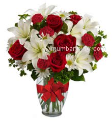 Glass vase with 5 PC White Lilies, 10 Red Roses, 10 Red Carnation and 10 Whit Gerberas with greens