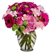 Mixed Flowers in a beautiful Vase in Pink and Rani Combinations artistically decorated a Romantic gift.