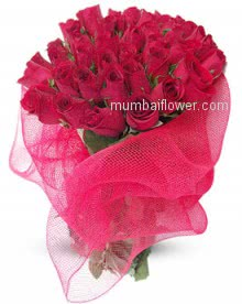 Beautifully decorated with net a Bunch of 30 Valentine Red Roses