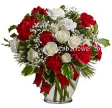 Valentine Red and White Flowers in a Simple Glass Vase a beautiful gift for your love will make evening of both of you. Please note we may substitute vase or container as per availability. 20 Red and White Carnation and 10 White Roses