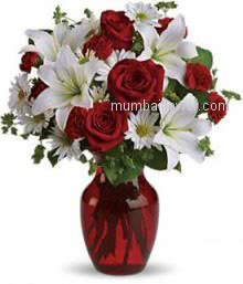 Valentine Red Roses and White Lilies in a Clear Simple Glass Vase a wonderful arrangement. 10 Red Roses, 10 White gerberas and 4 PC White Lilies