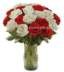 30 Valentine Red and White Roses in a Clear Glass Vase beautifully decorated.
