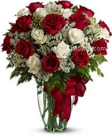 Valentine Red and White Roses in a clear glass Vase decorated beautifully. 30 Red and White