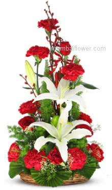 A unique arrangement of 10 Red Roses 10 Red Carnation and 2 White Lilies nicely decorated with fillers and greens for any occasion.
