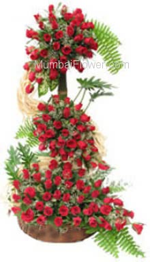Your feelings reach new heights with this expression of Love.. Tall Arrangement of 100 Red Roses