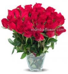 Red roses is a symbol of love send 30 Red Roses in a Vase to your sweetheart.