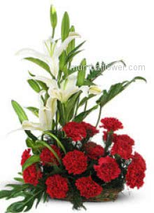 Let the special person in your life know how lucky you feel to have him/ her with this beautiful Arrangement of 15 Red Carnation and 3 White Lilies nicely decorated with Greens.