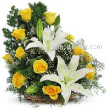 Yellow and white roses can indicate happiness and celebration. Arrangement of 12 Yellow Roses and 2 White Lilies nicely decorated with Greens