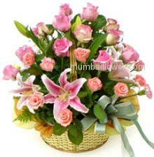 Richest and purest Basket of 30 Pink Roses and 2 Pink Lilies Nicely Decorated with fillers and Ribbons.