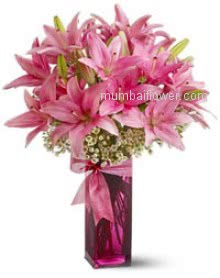 Bunch of 10 Beautiful Pink Lilies nicely decorated with fillers and Ribbons send for the special occasion.  <br>Note : Color of Lilies may vary. Clear Glass vase is included.