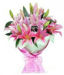 A pink one meant perfect happiness. Bunch of 5 Pink Lilies for your loved ones nicely decorated with Ribbons.