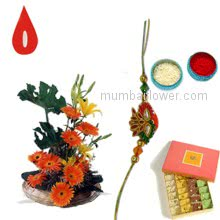 Arrangement of 10 pc Orange Gerberas and 2 pc Yellow Lilies and 250 gm. Mixed Mithai with 1 pc. Rakhi