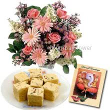 Hamper includes pack of 500gm sone papri sweet with bunch of 10 mixed seasonal flowers and a diwali greeting card.