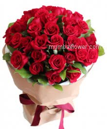 Bunch of 40 Red Roses nicely decorated with filler and ribbons and packed with Paper Packing.