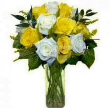 Glass Vase with 20 White and Yellow Roses nicely decorated with filler and greens