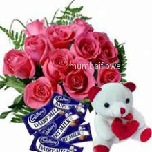 Bunch of 12 pink Roses with fillers and ribbons and 6 inch Teddy with 5pc Dairymilk Chocolate