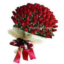 Bunch of 100 Red Roses nicely decorated with fillers and ribbons