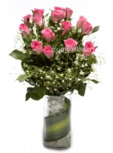Glass vase with 15 Pink Roses nicely decorated with fillers and greens