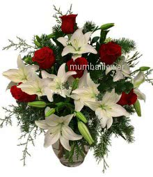 Bunch of 6 White Lilies and 10 Red Roses nicely decorated with fillers and ribbons.