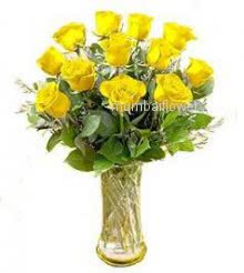 Glass vase with 12 Yellow Roses nicely decorated with fillers and grens