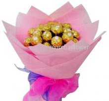 Chocolate Hand Bouquet of 24pc Ferrero Rocher Chocolates nicely decorated with ribbons... Please color of paper n design will be changed on final shipping